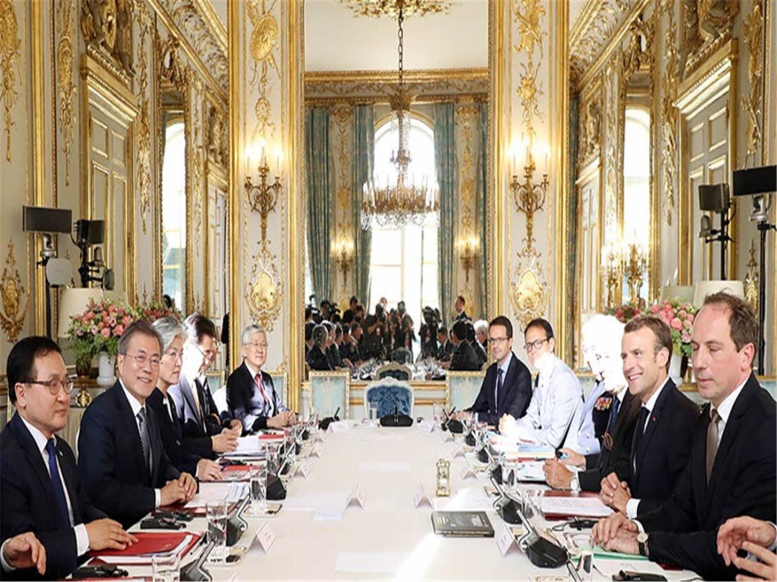The President and French President Emmanuel Macron Hold Summit